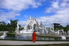 Buddhist Monk and White Temple. Stock Photography