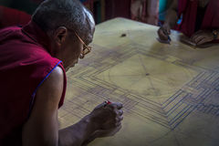 Buddhist Monk working on mandala in Diskit Gompa, Ladakh Royalty Free Stock Photo