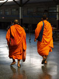 Buddhist Monks. BANGKOK, THAILAND - JUNE 7: Thai Buddhist monks walk through Bangkok's Hua Lamphong train station June 7, 2010 in Bangkok. There are an estimated Royalty Free Stock Image