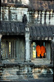 Buddhist Monks. Two Buddhist Monks at a door way at Angkor Wat in Cambodia Stock Image
