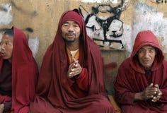Buddhist Monks. Tibetan Buddhist Moks chanting at Boudhanath Stupa in Kathmandu, Nepal Stock Photos
