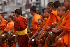 Buddhist Monks. A line of Buddhist monks during the morning offerings Stock Images