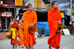 Buddhist Monks alms giving Royalty Free Stock Image