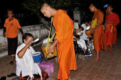 Buddhist Monks alms giving Royalty Free Stock Photos