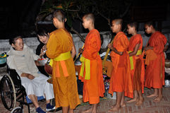 Buddhist Monks alms giving Royalty Free Stock Images