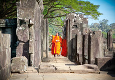 Buddhist monks in Angkor Wat complex. Cambodia. Royalty Free Stock Photography