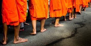 Buddhist monks are barefoot on road Royalty Free Stock Images