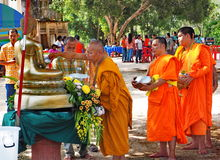 Buddhist monks bathe the Buddha, Songkran festival. BAN NA SAN - SURAT THANI PROVINCE - THAILAND - APRIL 11, 2014: Buddhist monks led by a senior monk bathe the royalty free stock photos