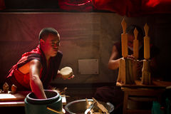 Buddhist Monks from Bhutan make candles in their Bhutan Temple i Stock Photos