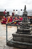 Buddhist monks blessing people at Buddhist Shrine Swayambhunath Stupa. Nepal, Kathmandu Stock Images