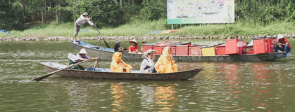 Buddhist monks in boat, Perfume Pagoda, Hanoo, Vietnam. Robed Buddhist monks in wooden boar on river near Perfume Pagoda, Hanoo, Vietnam Stock Image