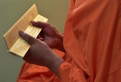 Buddhist monks chant during the ordain into monkhood. Buddhist monk chants dhamma during the ordain into monkhood at the temple Stock Photography