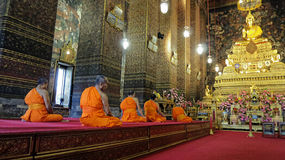 Buddhist monks chanting in the Royal temple Stock Photography