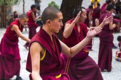 Buddhist monks` debating practice , drastic debating , Tibet stock image