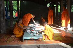Buddhist monks eating Stock Images