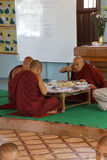 Buddhist monks eating Stock Photos
