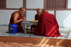 Buddhist monks eating Royalty Free Stock Photos