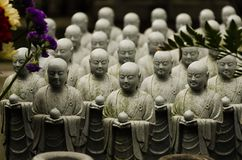 Stone statue of Buddhist monks sitting and praying stock photos