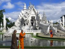Buddhist Monks, Fountain and White Temple. Royalty Free Stock Photo