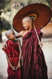 Buddhist monks. Friends.Smiling kids. royalty free stock photo