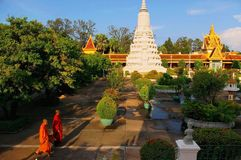 Buddhist monks in garden of Royal Palace Stock Image