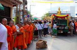 Buddhist monks is given food offering from people at the morning Stock Photography