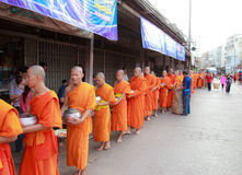 Buddhist monks is given food offering from people at the morning Royalty Free Stock Photos