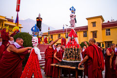 Buddhist monks of Gyuto monastery, Dharamshala, India. Tibetan Buddhist monks carry a traditional Buddhist sculpture at a Puja at the temple of Gyuto monastery Royalty Free Stock Images