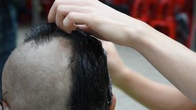 Buddhist monks hair shave. stock footage