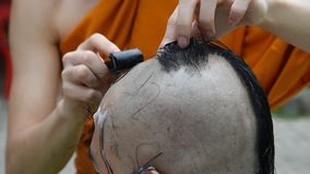Buddhist monks hair shave. stock video footage