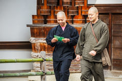 Buddhist monks at Kinkakuji Temple in Kyoto Stock Image