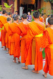 Buddhist monks, Laos. Buddhist monks collecting alms in Luang Prabang, Laos Stock Photo