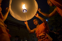 Buddhist Monks Launching Fire Lanterns at Festival Stock Photos
