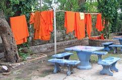 Buddhist monks laundry with orange robes Stock Photo