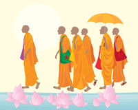 Buddhist monks with lotus Stock Photos
