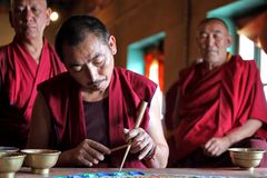 Buddhist monks making sand mandala Royalty Free Stock Photos