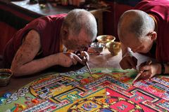 Buddhist monks making sand mandala Royalty Free Stock Photo