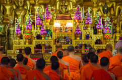 Buddhist Monks in meditation in a temple Stock Photos