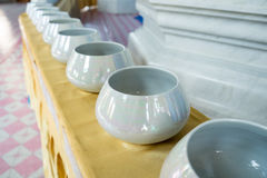 The Buddhist monks for merit. Bowls arranged in a line for Buddhist merit Stock Photo