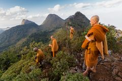 Buddhist monks at mountain's top Royalty Free Stock Photos