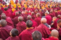 Buddhist monks near stupa Boudhanath during festive Puja of H.H. Drubwang Padma Norbu Rinpoche's reincarnation's. KHATMANDU, NEPAL - DEC 15: Unidentified tibetan royalty free stock photography