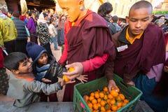 Buddhist monks near stupa Boudhanath during festive Puja of H.H. Drubwang Padma Norbu Rinpoche's reincarnation's. Unidentified tibetan Buddhist monks near stupa royalty free stock photos