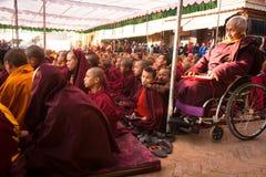 Buddhist monks near stupa Boudhanath during festive Puja of H.H. Drubwang Padma Norbu Rinpoche's reincarnation's. Unidentified tibetan Buddhist monks near stupa royalty free stock image