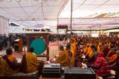 Buddhist monks near stupa Boudhanath during festive Puja of H.H. Drubwang Padma Norbu Rinpoche's reincarnation's Stock Photo