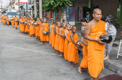 Buddhist monks. And novices dry food at Banbung, Chonburi, Thailand Taken Date 2015-April-08 Royalty Free Stock Photography