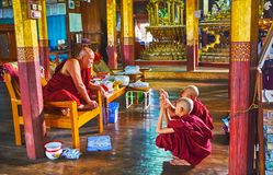 Buddhist monks in old monastery on Inle Lake, Myanmar Stock Image