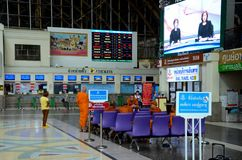 Buddhist monks passengers in robes wait in Hua Lamphong railway station Bangkok Thailand. Bangkok, Thailand - December 15, 2015: A group of  Thail monks in Stock Photo