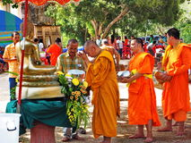 Buddhist monks pay respect to the Buddha, Songkran festival, Thailand. BAN NA SAN - SURAT THANI PROVINCE - THAILAND - APRIL 11, 2014: Buddhist monks led by a Stock Image