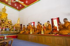 Buddhist monks pray on Buddha Statue, focus selective royalty free stock image