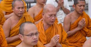 Buddhist monks pray at Shwedagon Pagoda in Yangon, Myanmar Royalty Free Stock Photography
